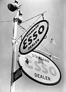 Lamp Post Prints - Esso. Gasoline Sign On Chestnut Street Print by Everett