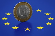 European Union Prints - Euro Coin Standing On European Union Flag Print by Bjorn Holland