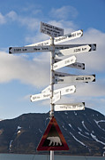 Pole Position Prints - Europe, Norway, Spitsbergen, Svalbard, Longyearbyen, Directional Sign With Caution Polar Bear Sign Print by Westend61