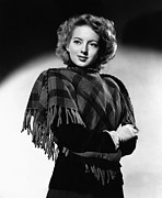 Poncho Photo Framed Prints - Evelyn Keyes, 1943 Framed Print by Everett
