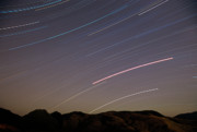 Stars Photos - Evening Splendor-Star Trails by Sandra Bronstein