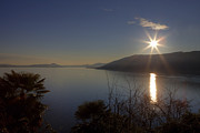 Light Rays Photo Prints - evening sun over the Lake Maggiore Print by Joana Kruse