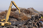 Garbage Photo Prints - Excavator Moving Scrap Metal with Electro Magnet Print by Jeremy Woodhouse