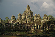 Angkor Thom Prints - Exterior Of Angkors Bayon Temple Ruins Print by Richard Nowitz