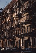 New York City Fire Escapes Posters - Exterior View Of Buildings With Fire Poster by Ira Block