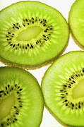Brightly Lit Framed Prints - Extreme Close-up Of Four Pieces Of Sliced Kiwi Fruit, Part Of Framed Print by Medioimages/Photodisc