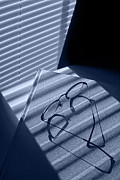 Venetian Blinds Photos - Eye glasses book and venetian blind in blue by Randall Nyhof
