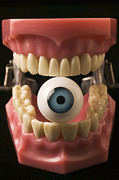 Surrealism Photo Posters - Eye held by teeth Poster by Garry Gay