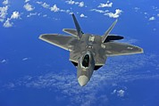 Guam Prints - F-22 Raptor Fighter Flies Near Guam Print by Everett