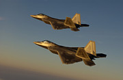 Plane Prints - F-22a Raptors Fly Over Langley Air Print by Stocktrek Images