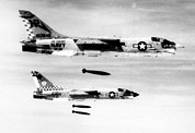 Explosives Prints - F-8 Aircraft Release Bombs On North Print by Everett