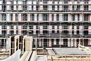 Construction Frame Framed Prints - Facade Of Buildings Under Construction Framed Print by Corepics