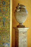 Tiled Posters - Faience tiles and a sculpted vase decorating the Patio del Crucero in the Alcazar of Seville Poster by Sami Sarkis