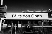 Gallic Prints - Failte Don Oban Welcome To Oban In Scots Gaelic Sign At Oban Train Station Scotland Uk Print by Joe Fox