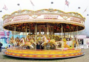 Whirligig Framed Prints - Fairground Carousel Framed Print by Johnny Greig