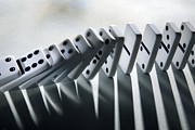 Cause And Effect Photo Prints - Falling Dominoes Print by Victor De Schwanberg