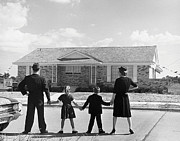 Home Ownership Prints - Family Holding Hands, Looking At A House For Sale (1950) Print by Archive Holdings Inc.