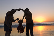 Man Holding Baby Art - Family Portrait On The Beach At Sunset by Rich Reid