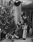35-39 Years Prints - Family With Three Children (4-9) Standing At Christmas Tree, (b&w) Print by George Marks