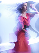 Glass Wall Posters - Fashion Photo of a Woman in Shining Blue Settings Wearing a Red  Poster by Oleksiy Maksymenko