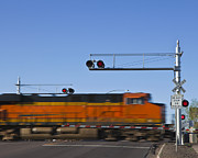 Flashing Photo Prints - Fast Moving Train at a Railroad Crossing Print by Paul Edmondson