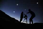 Child Star Posters - Father And Son Looking Through A Telescope At Nigh Poster by Chris Stein