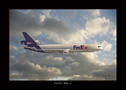 Airplane Photo Framed Prints - FedEx MD-11 Framed Print by Larry McManus