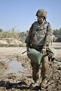 Physical Fitness Posters - Female Airman Carries A Sandbag Poster by Stocktrek Images