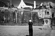 Bruce Photos Prints - Female Asian Tourist Taking Photos Of The Robert The Bruce Statue Outside Stirling Castle Scotland U Print by Joe Fox