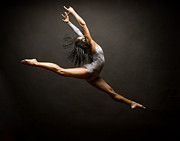 Ballet Dancer Photo Posters - Female Ballet Dancer Leaping In Air Poster by David Sacks