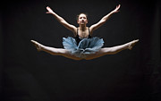 Ballet Dancer Photo Posters - Female Ballet Dancer Performing Splits In Air Poster by David Sacks