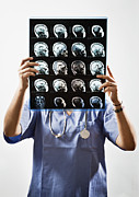 Human Brain Art - Female Doctor Holds Up Mri In Front Of Her Face by Ron Levine