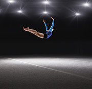 World Series Prints - Female Gymnast Jumping Through Air Print by Robert Decelis Ltd