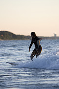Surfer Photos - Female surfer riding a wave in Lake Michigan by Purcell Pictures