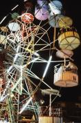 Ferris Wheel Night Photography Framed Prints - Ferris Wheel At Fairground Framed Print by Axiom Photographic
