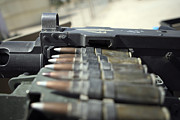Fed Prints - Fifty-caliber Machine Gun Rounds Print by Stocktrek Images