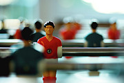 Teamwork Prints - Figurine Of Football Player Print by D.Reichardt