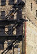 Brick Buildings Prints - Fire Escape Steps On A Building Print by Stacy Gold