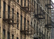 Urban Scenes Photo Metal Prints - Fire Escapes On Brownstone Apartment Metal Print by Everett