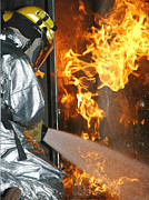 Courage Metal Prints - Firefighter Extinguishes A Simulated Metal Print by Stocktrek Images