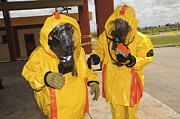 Obscured Face Art - Firefighters Dressed In Hazmat Suits by Stocktrek Images