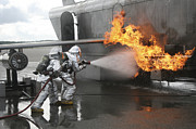 Courage Metal Prints - Firefighters Extinguish An Exterior Metal Print by Stocktrek Images