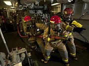 Carrier Posters - Firemen Combat A Simulated Fire Aboard Poster by Stocktrek Images