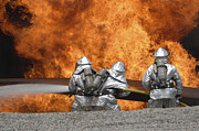 Oxygen Tank Framed Prints - Firemen Neutralize A Fire Framed Print by Stocktrek Images