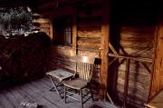 Log Cabins Photo Posters - Firewood And A Chair On The Porch Poster by Joel Sartore