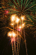 Pyrotechnics Photos - Fireworks in night sky by Garry Gay