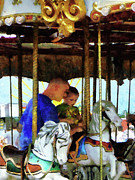 Merry-go-round Prints - First Carousel Ride Print by Susan Savad