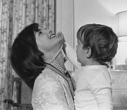 Candid Family Portraits Posters - First Lady Jacqueline Kennedy Laughs Poster by Everett