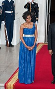 Blue Lame Framed Prints - First Lady Michelle Obama Wearing Framed Print by Everett