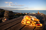 Chippy Photos - Fish n Chips by the beach by Rob Hawkins